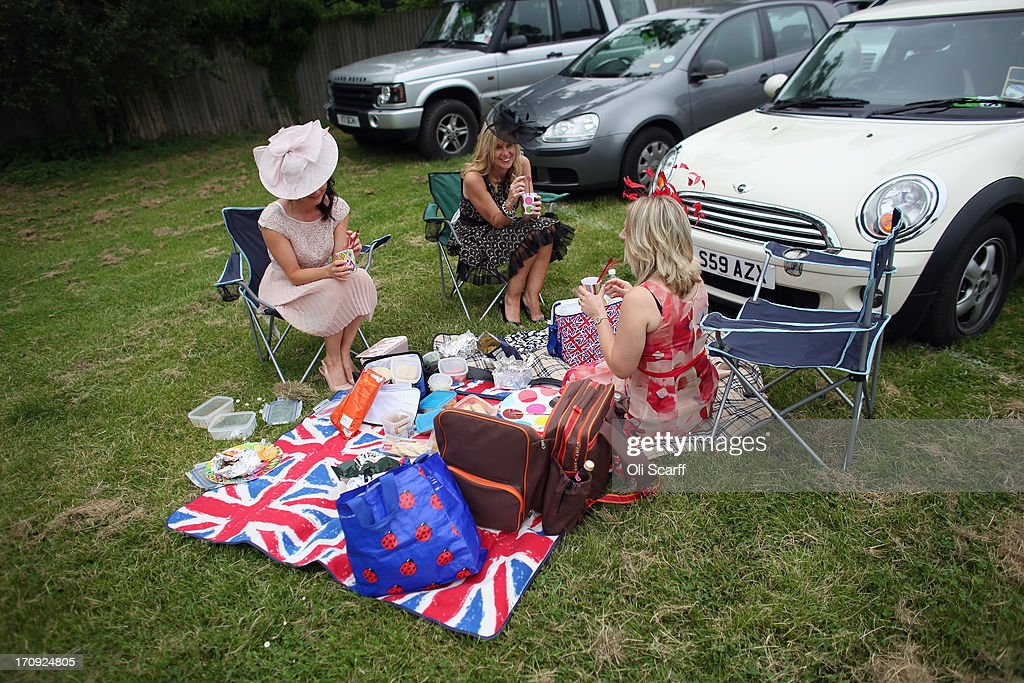 Racegoers picnic by their car adjacent to Ascot racecourse before attending Royal Ascot on June 20, 2013 in Ascot, England. The 'Royal Ascot' horse race meeting runs from June 18, 2013 until June 22, 2013 and has taken place since 1711. The racecourse is expected to welcome around 280,000 racegoers over the five days, including Her Majesty The Queen and other members of the Royal Family.