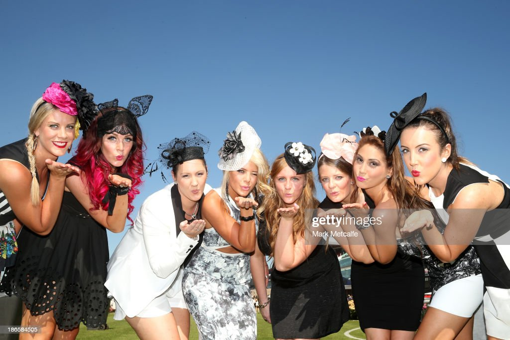 Racegoers pose for a photo on Victoria Derby Day at Flemington Racecourse on November 2, 2013 in Melbourne, Australia.