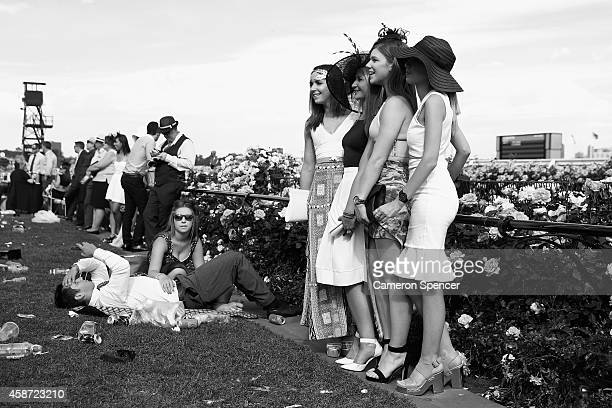 Racegoers pose for a photograph on Melbourne Cup Day at Flemington Racecourse on November 4 2014 in Melbourne Australia
