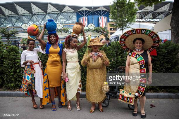 Racegoers pose for and take pictures on day 3 of Royal Ascot at Ascot Racecourse on June 22 2017 in Ascot England The fiveday Royal Ascot meeting is...