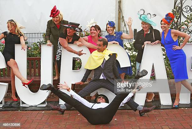 Racegoers pose for photographs on Melbourne Cup signage following 2015 Melbourne Cup Day at Flemington Racecourse on November 3 2015 in Melbourne...