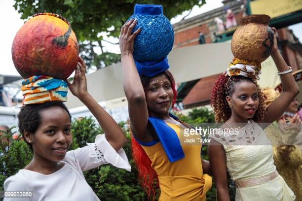 Racegoers pose for pictures on day 3 of Royal Ascot at Ascot Racecourse on June 22 2017 in Ascot England The fiveday Royal Ascot meeting is one of...