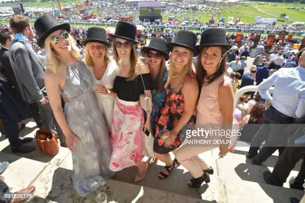 Racegoers pose on the second day of the Epsom Derby Festival in Surrey southern England on June 3 2017 / AFP PHOTO / Anthony Devlin