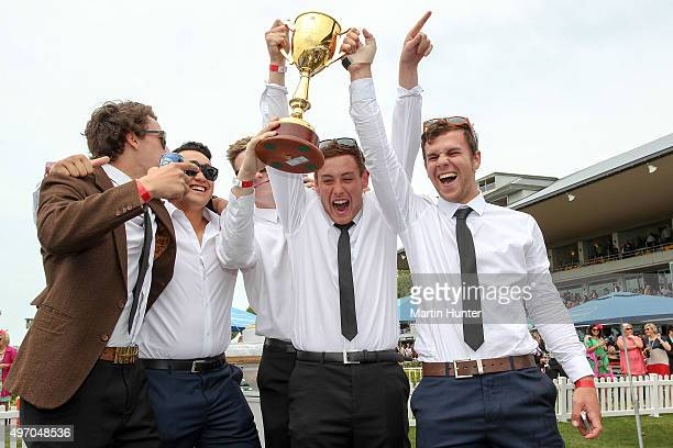 Racegoers poses with the NZ Cup during Christchurch Casino New Zealand Cup Day at Riccarton Park Racecourse on November 14 2015 in Christchurch New...