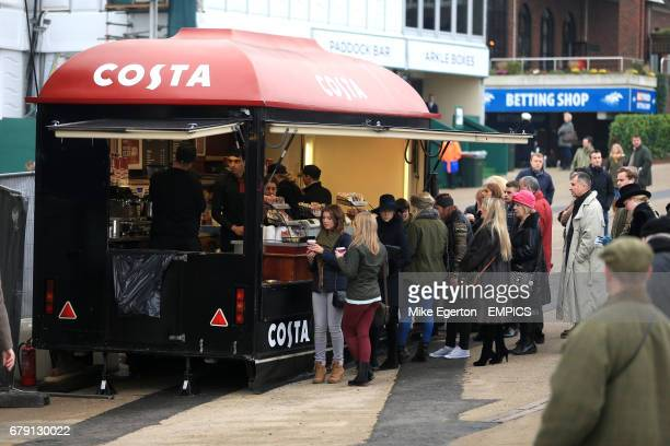 Racegoers queue at a Costa coffee stand at Cheltenham Racecourse
