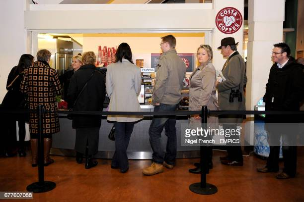 Racegoers queue for a coffee at Costa Coffee at Sandown Park