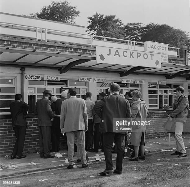 Racegoers queue up to place bets and collect winnings at Goodwood Racecourse West Sussex 28th July 1967