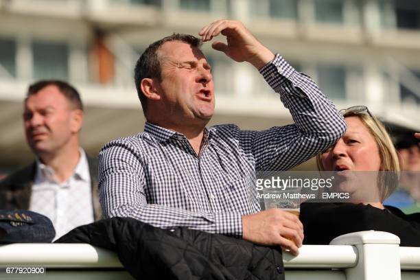 A racegoers reacts as his horse fails to win at Lingfield Park racecourse