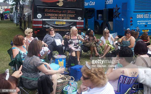 Racegoers relax in lawn chairs outside their tour buses After over a decade of Labour Government in Great Britain the gap between the wealthy and the...