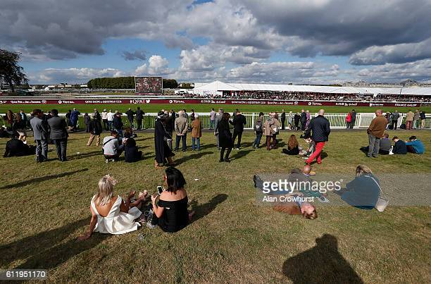 Racegoers relaxing before a race at Chantilly racecourse on October 02 2016 in Chantilly France