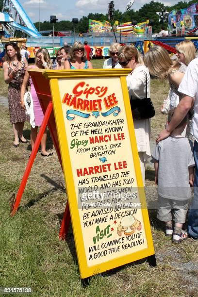 Racegoers seek advice of a fortune teller at Epsom Downs Racecourse