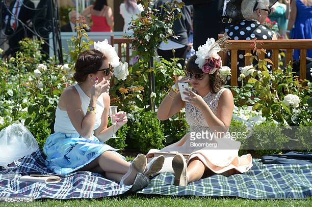 Racegoers sit on a picnic blanket during Melbourne Cup day at the Flemington racecourse in Melbourne Australia on Tuesday Nov 3 2015 The Melbourne...