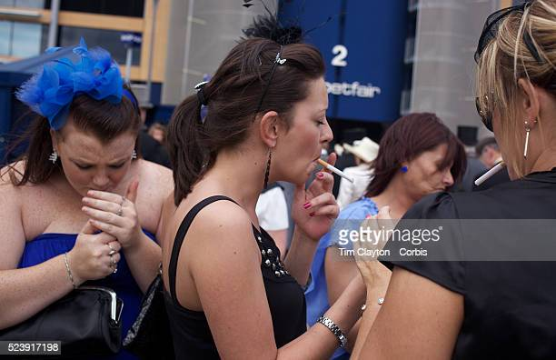 Racegoers smoke their cigarettes After over a decade of Labour Government in Great Britain the gap between the wealthy and the poor is as large as...