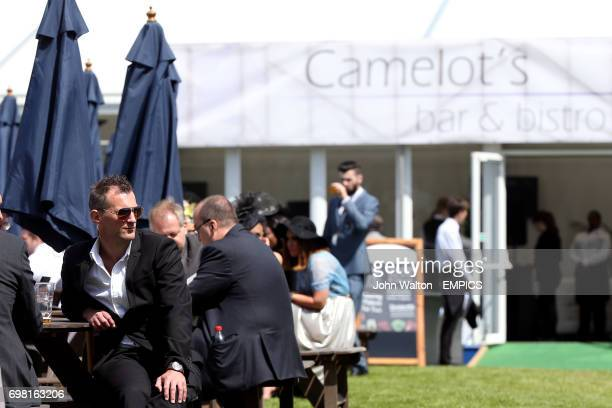 Racegoers soak up the atmosphere at Camelot's Bar and Bistro at Epsom Downs Racecourse