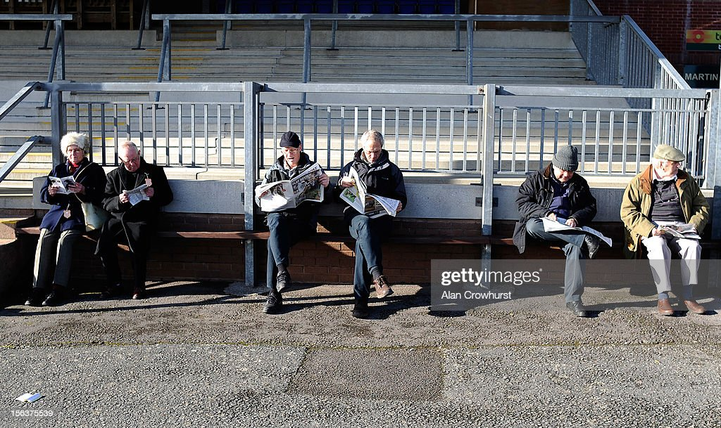 Racegoers study the form before the first at Exeter racecourse on November 14, 2012 in Exeter, England.