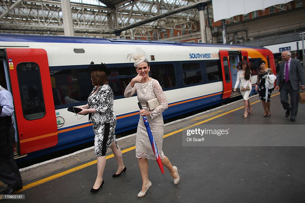 Racegoers travel by train from Waterloo station to Ascot racecourse to attend Royal Ascot on June 20, 2013 in London, England. The 'Royal Ascot' horse race meeting runs from June 18, 2013 until June 22, 2013 and has taken place since 1711. The racecourse is expected to welcome around 280,000 racegoers over the five days, including Her Majesty The Queen and other members of the Royal Family.