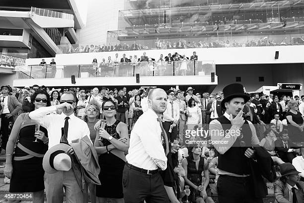 Racegoers watch a race on Melbourne Cup Day at Flemington Racecourse on November 4 2014 in Melbourne Australia