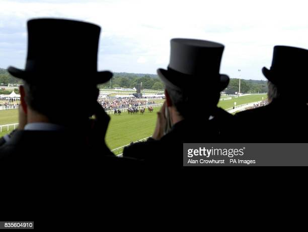 Racegoers watch from the grandstand as Ryan Moore wins The Wolferton Handicap Stakes on Perfect Stride during day four of The Royal Ascot at Ascot...