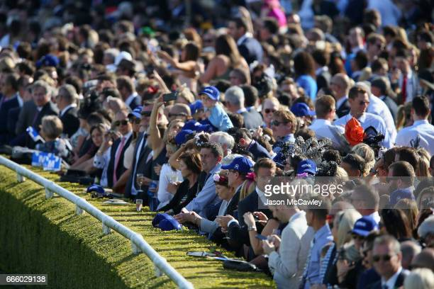 Racegoers watch on during The Championships Day 2 Queen Elizabeth Stakes Day at Royal Randwick Racecourse on April 8 2017 in Sydney Australia