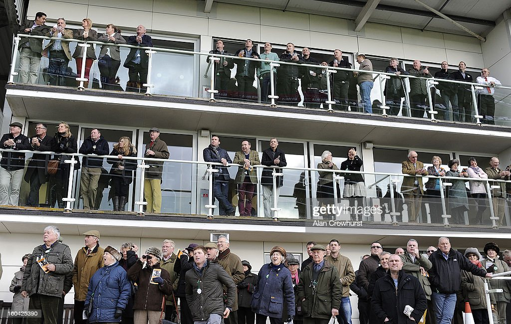 Racegoers watch the action at Wincanton racecourse on January 31, 2013 in Wincanton, England.