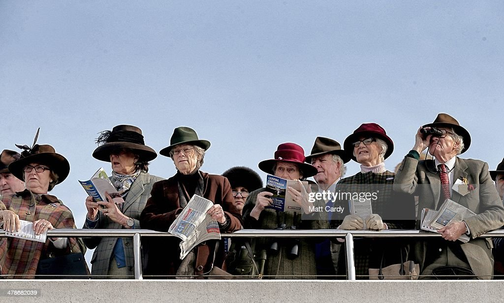 Racegoers watch the parade ring on the final day of the Cheltenham Festival on March 14, 2014 in Cheltenham, England. Thousands of racing enthusiasts have been at the four-day festival, which ends today with the festival's Gold Cup and is seen as many as the highlight of the jump racing calendar.