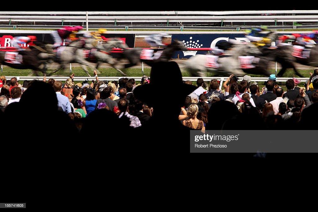 Racegoers watch the races on Crown Oaks Day at Flemington Racecourse on November 8, 2012 in Melbourne, Australia.