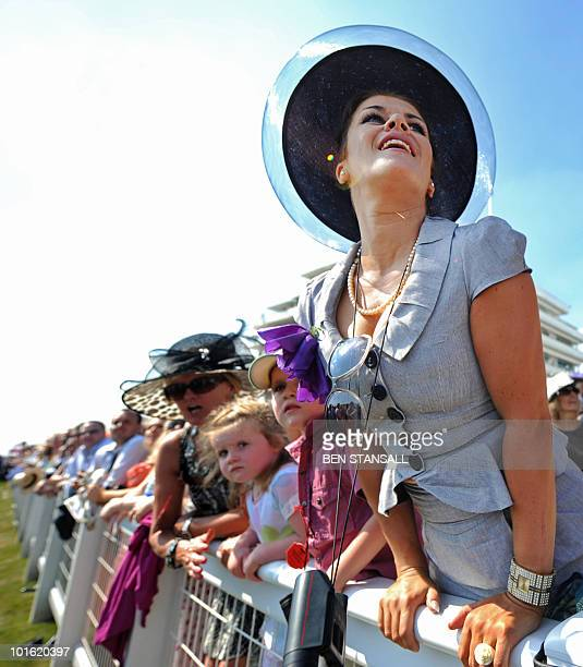 Racegoers watche the Oaks horse race on the first day of the Epsom Derby in Surrey southern England on June 4 2010 AFP PHOTO/ BEN STANSALL