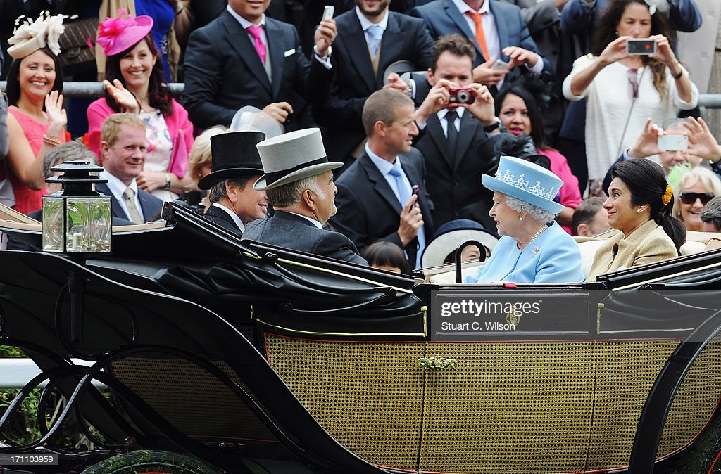 Racegoers wave at Queen Elizabeth II, Prince El Hassan Bin Talal, Princess Sarvath El Hassan and <a gi-track='captionPersonalityLinkClicked' href=/galleries/search?phrase=John+Warren+-+Raceadviseur&family=editorial&specificpeople=14677107 ng-click='$event.stopPropagation()'>John Warren</a> as they arrive with the Royal Procession on day five of Royal Ascot at Ascot Racecourse on June 22, 2013 in Ascot, England.