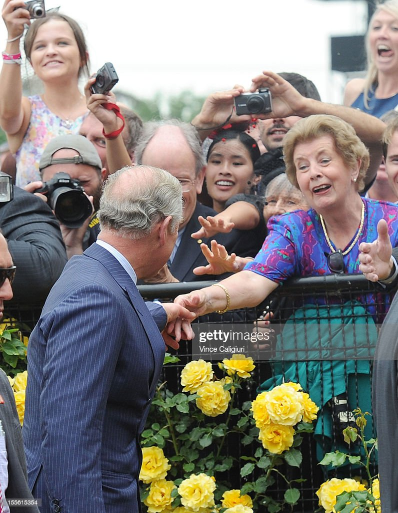 Racegoers wave to Prince Charles, Prince of Wales as he arrived in the mounting yard during 2012 Melbourne Cup Day at Flemington Racecourse on November 6, 2012 in Melbourne, Australia.