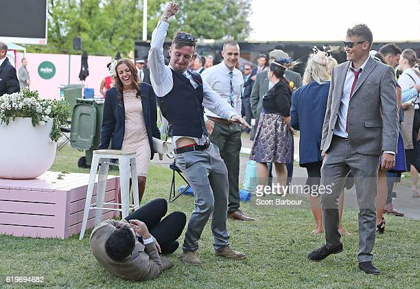 Racegoers wrestle following 2016 Melbourne Cup Day at Flemington Racecourse on November 1 2016 in Melbourne Australia