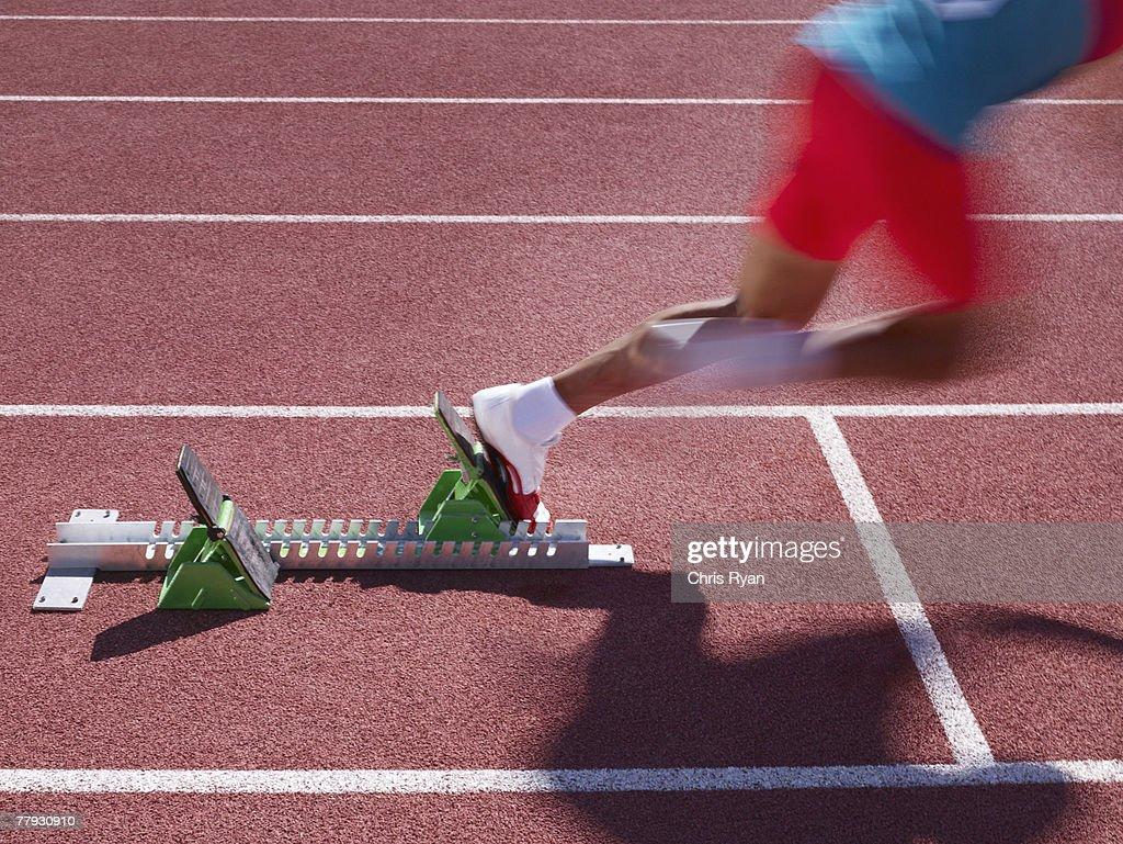 Racer at start line on track : Stock Photo