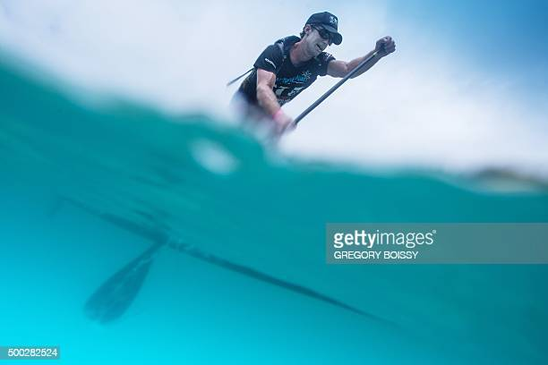TOPSHOT A racer competes in the 45km standing paddle race on December 5 2015 in Papeete as part of the 15th annual edition of the Bora Bora Ironmana...