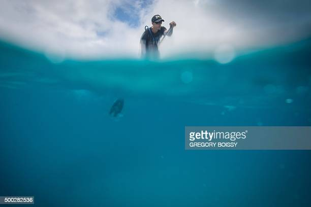 A racer competes in the 45km standing paddle race on December 5 2015 in Papeete as part of the 15th annual edition of the Bora Bora Ironmana Liquid...