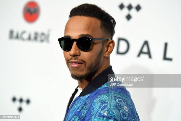 F1 racer Lewis Hamilton attends the Stream TIDAL X Brooklyn Benefit Concert at Barclays Center of Brooklyn on October 17 2017 in New York / AFP PHOTO...