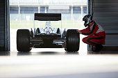 Racer working on car in garage