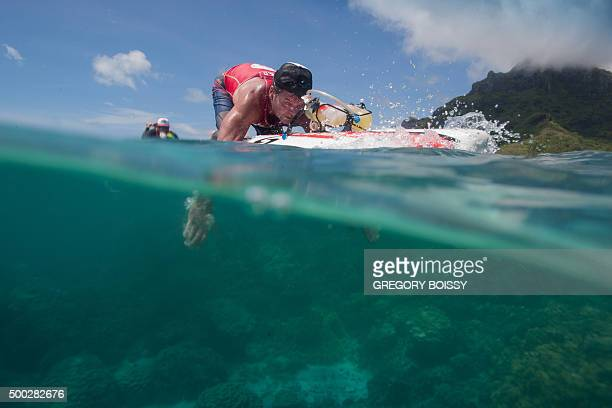 Racers compete in the 25km prone paddle race on December 5 2015 in Papeete as part of the 15th annual edition of the Bora Bora Ironmana Liquid...