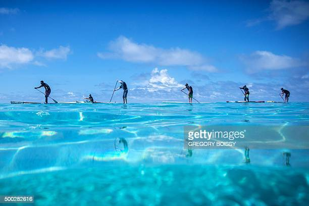 Racers compete in the 45km standing paddle race on December 5 2015 in Papeete as part of the 15th annual edition of the Bora Bora Ironmana Liquid...