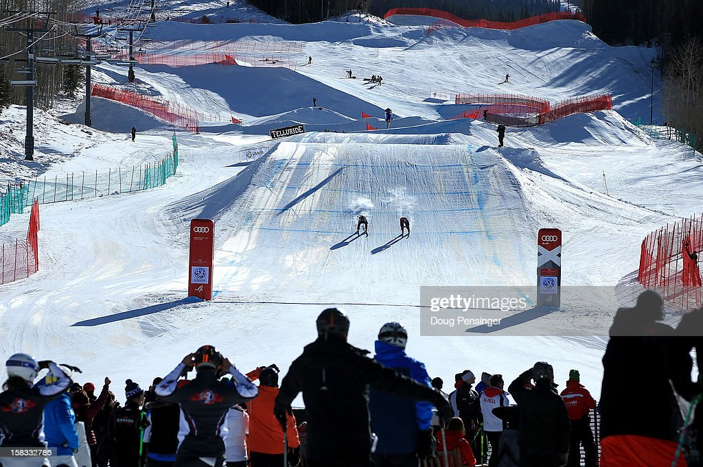 Racers head to the finish line as spectators get a view from the bottom of the course at the Audi FIS Ski Cross World Cup on December 12, 2012 in Telluride, Colorado.