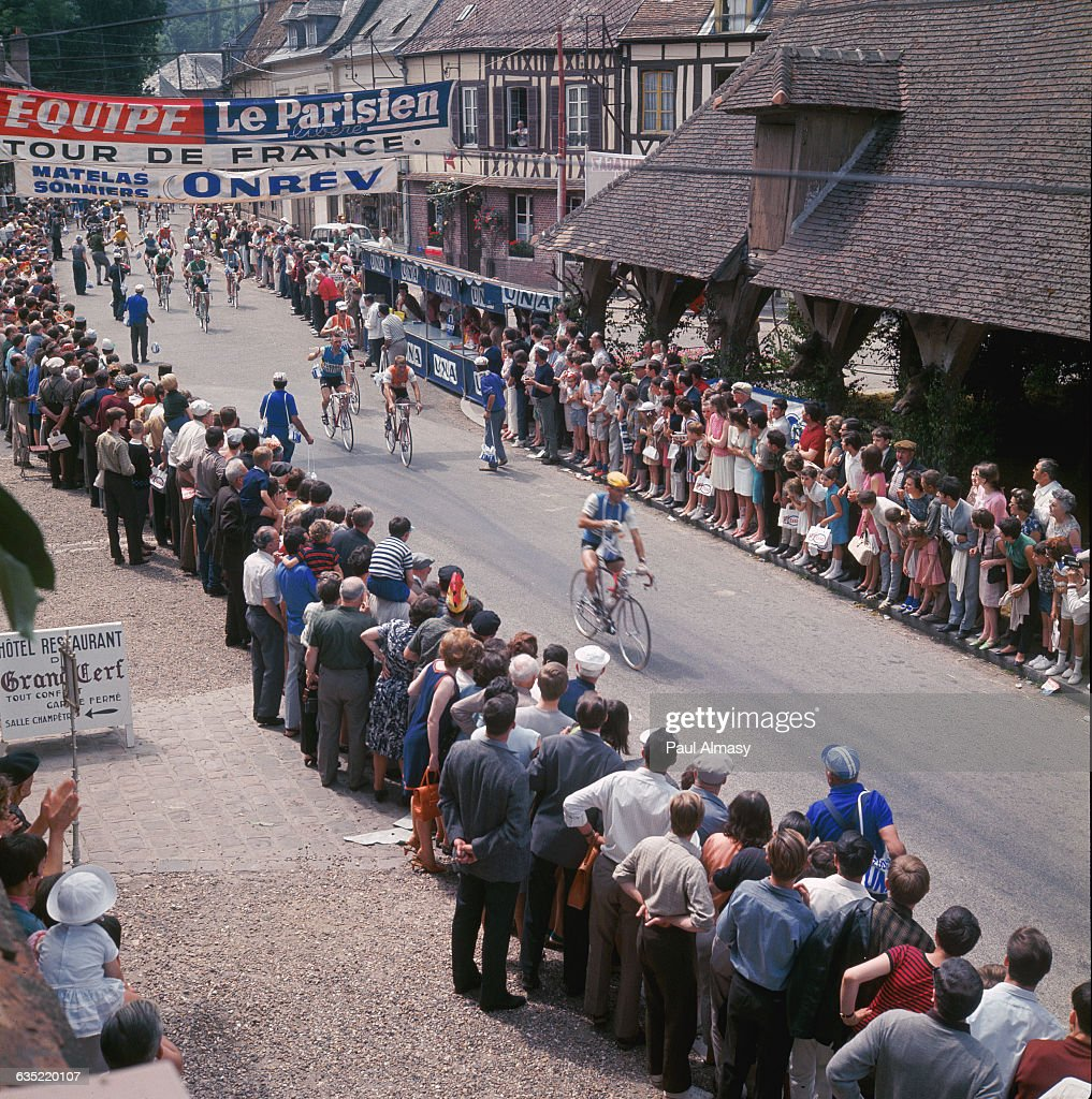Racers in the Tour de France of 1967 pass through the village of LyonslaForet