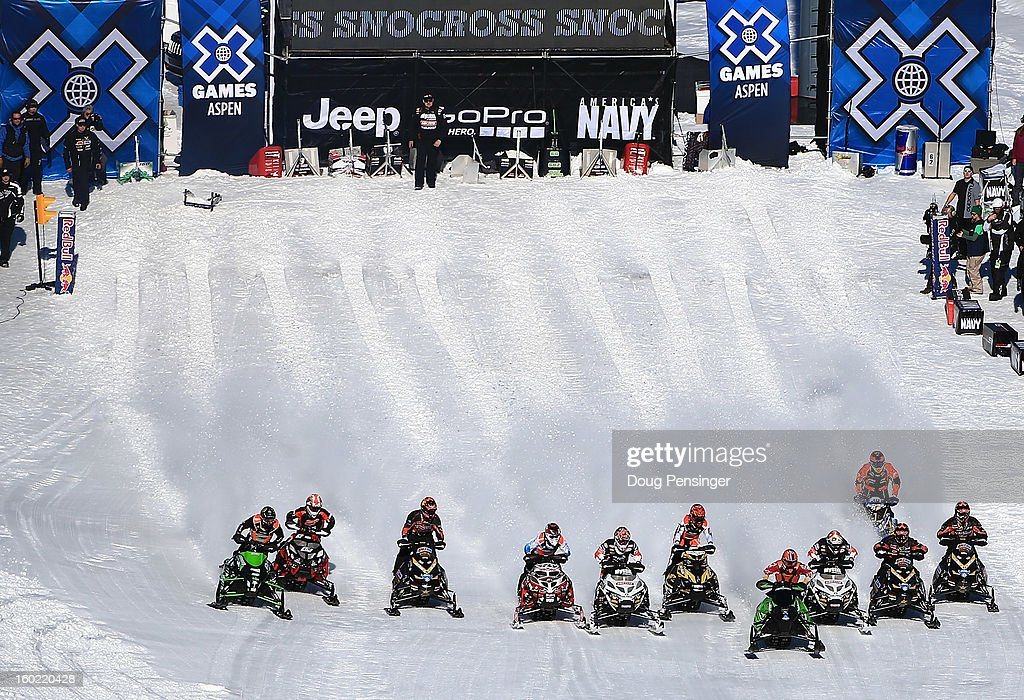Racers leave the start in the Snowmobile Snocross at Winter X Games Aspen 2013 at Buttermilk Mountain on January 27, 2013 in Aspen, Colorado.