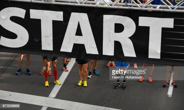 Racers stand at the start of the 35th annual Cherry Creek Sneak 10 mile race on April 23 2017 in Denver Colorado The popular annual race includes a...
