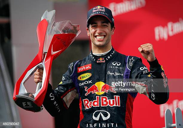 Racewinner Daniel Ricciardo of Australia and Infiniti Red Bull Racing lifts the trophy following his victory during the Canadian Formula One Grand...