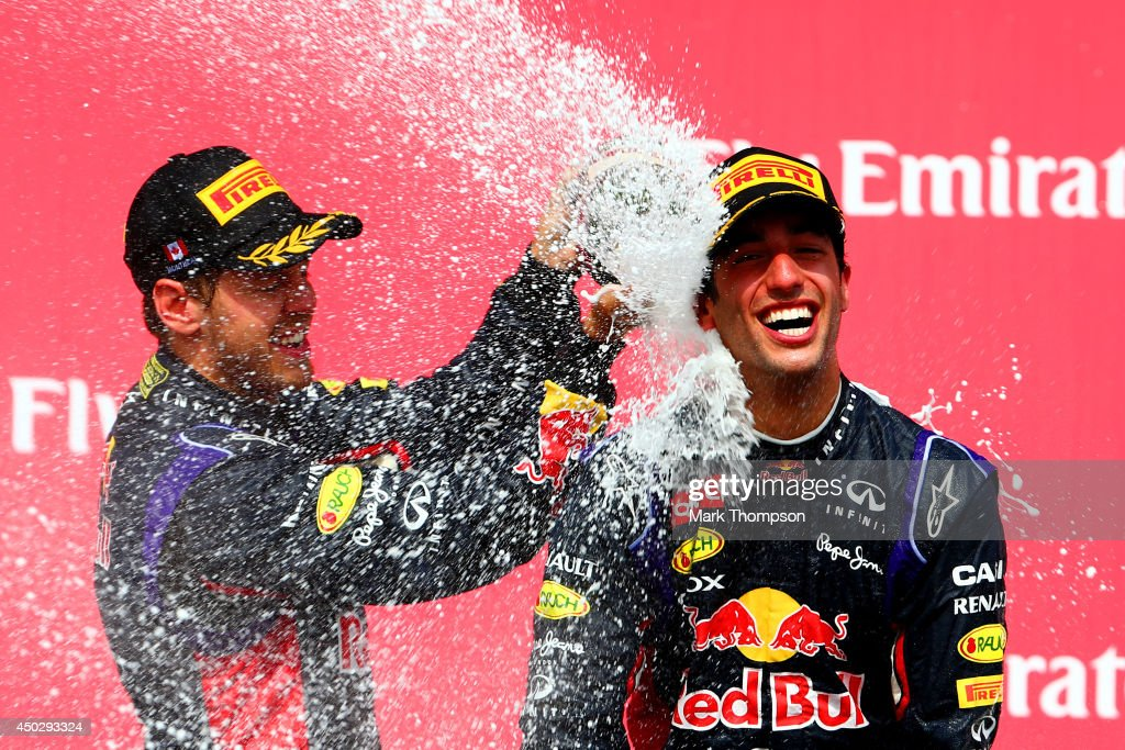 Racewinner <a gi-track='captionPersonalityLinkClicked' href=/galleries/search?phrase=Daniel+Ricciardo&family=editorial&specificpeople=6547569 ng-click='$event.stopPropagation()'>Daniel Ricciardo</a> of Australia and Infiniti Red Bull Racing is sprayed with champagne by teammate <a gi-track='captionPersonalityLinkClicked' href=/galleries/search?phrase=Sebastian+Vettel&family=editorial&specificpeople=2233605 ng-click='$event.stopPropagation()'>Sebastian Vettel</a> of Germany and Infiniti Red Bull Racing following his victory during the Canadian Formula One Grand Prix at Circuit Gilles Villeneuve on June 8, 2014 in Montreal, Canada.