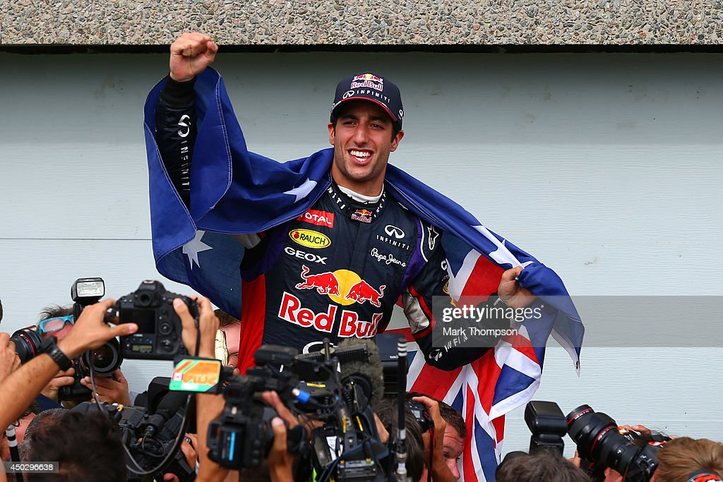 Racewinner Daniel Ricciardo of Australia and Infiniti Red Bull Racing is carried aloft by his pit crew following his frst grand prix victory during...