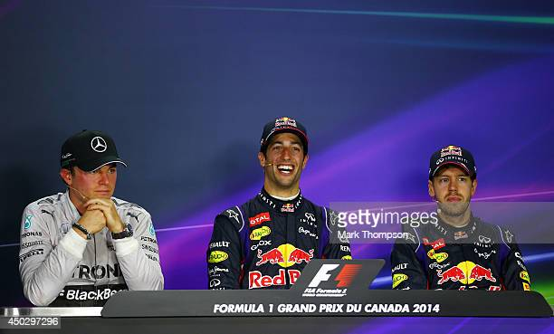 Racewinner Daniel Ricciardo of Australia and Infiniti Red Bull Racing speaks at a press conference with Nico Rosberg of Germany and Mercedes GP and...