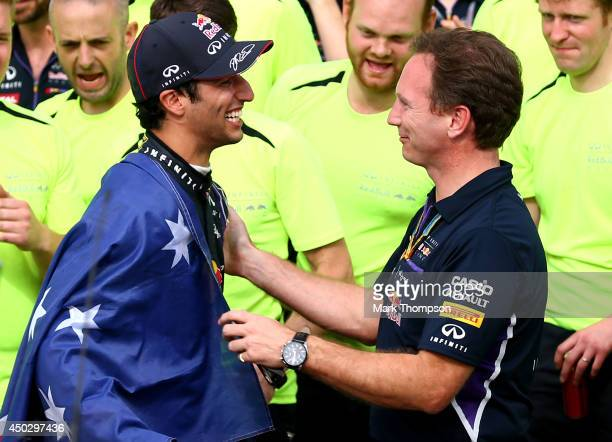 Racewinner Daniel Ricciardo of Australia and Infiniti Red Bull Racing celebrates wit Christian Horner the Infiniti Red Bull Racing Team Principal...