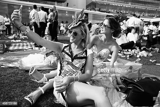 Racgoers take a 'selfie' on Melbourne Cup Day at Flemington Racecourse on November 4 2014 in Melbourne Australia