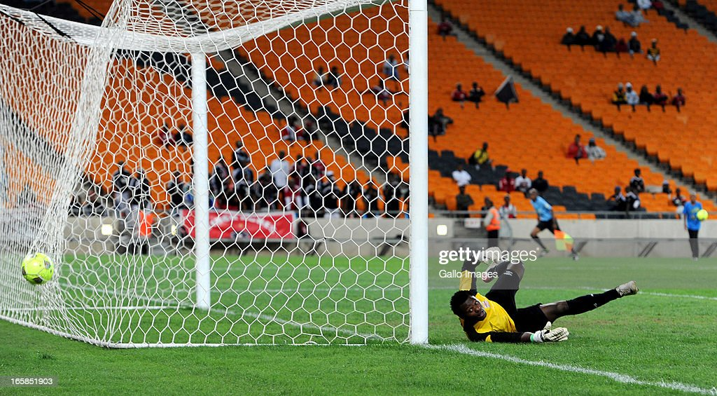 Racha Kola of Zanaco FC is beaten by a powerful shot from Khethowakhe Masuku of Pirates during the CAF Confedaration Cup match between Orlando Pirates and Zanaco at FNB Stadium on April 06, 2013 in Johannesburg, South Africa.
