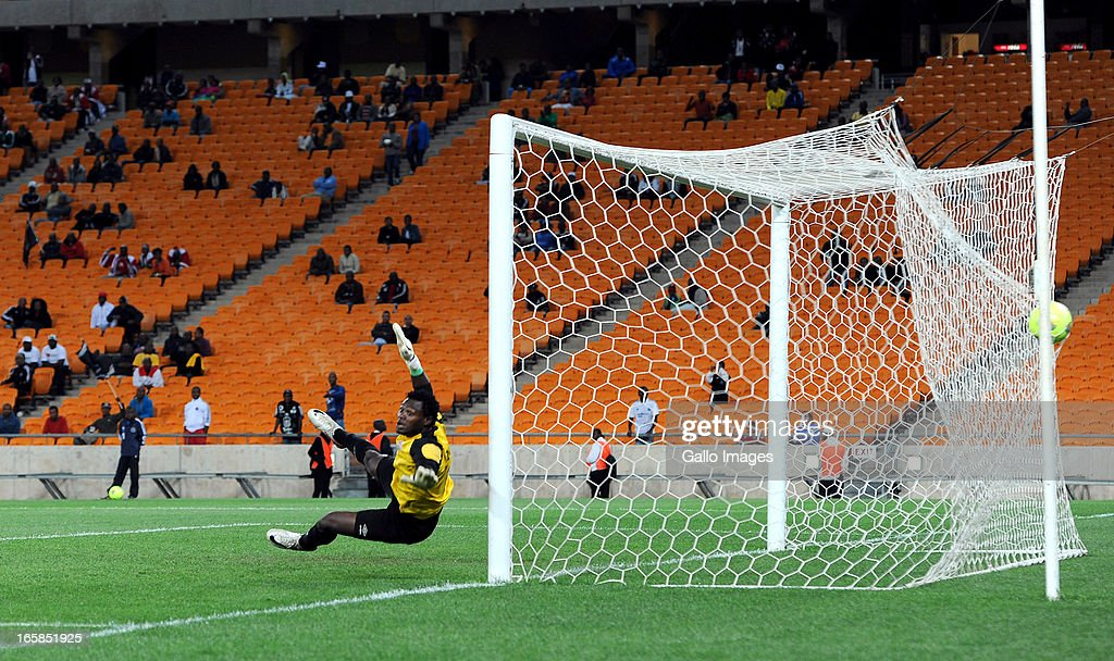 Racha Kola of Zanaco FC is beaten by a powerful shot from Mpho Makola of Pirates during the CAF Confedaration Cup match between Orlando Pirates and Zanaco at FNB Stadium on April 06, 2013 in Johannesburg, South Africa.
