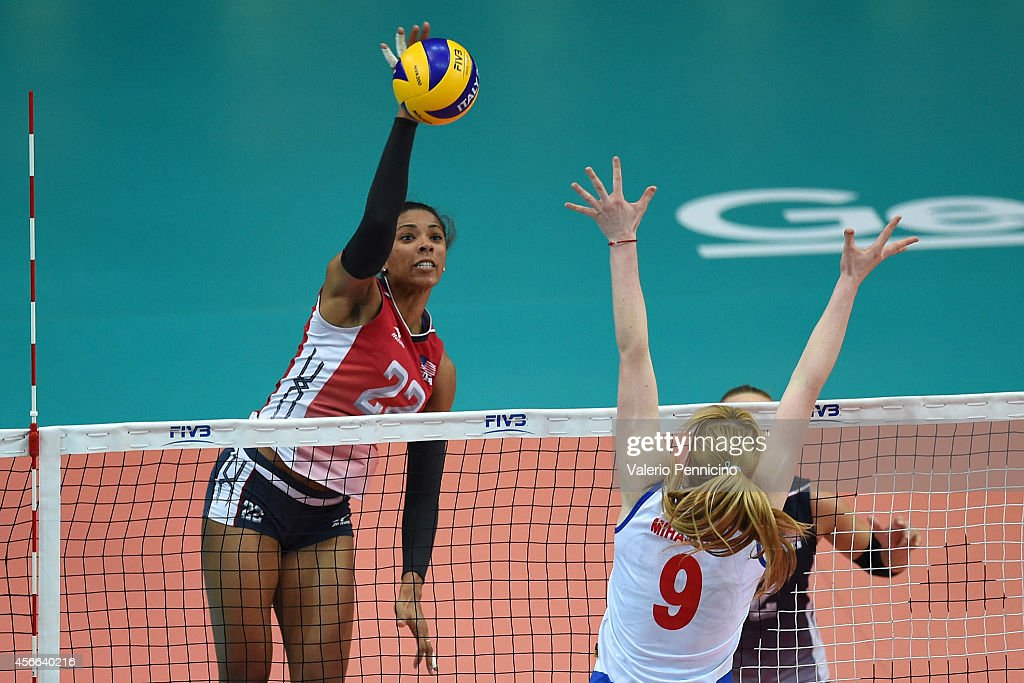 Rachael Adams of USA spikes as <a gi-track='captionPersonalityLinkClicked' href=/galleries/search?phrase=Brankica+Mihajlovic&family=editorial&specificpeople=9605568 ng-click='$event.stopPropagation()'>Brankica Mihajlovic</a> of Serbia blocks during the FIVB Women's World Championship pool F match between Serbia v USA on October 4, 2014 in Verona, Italy.
